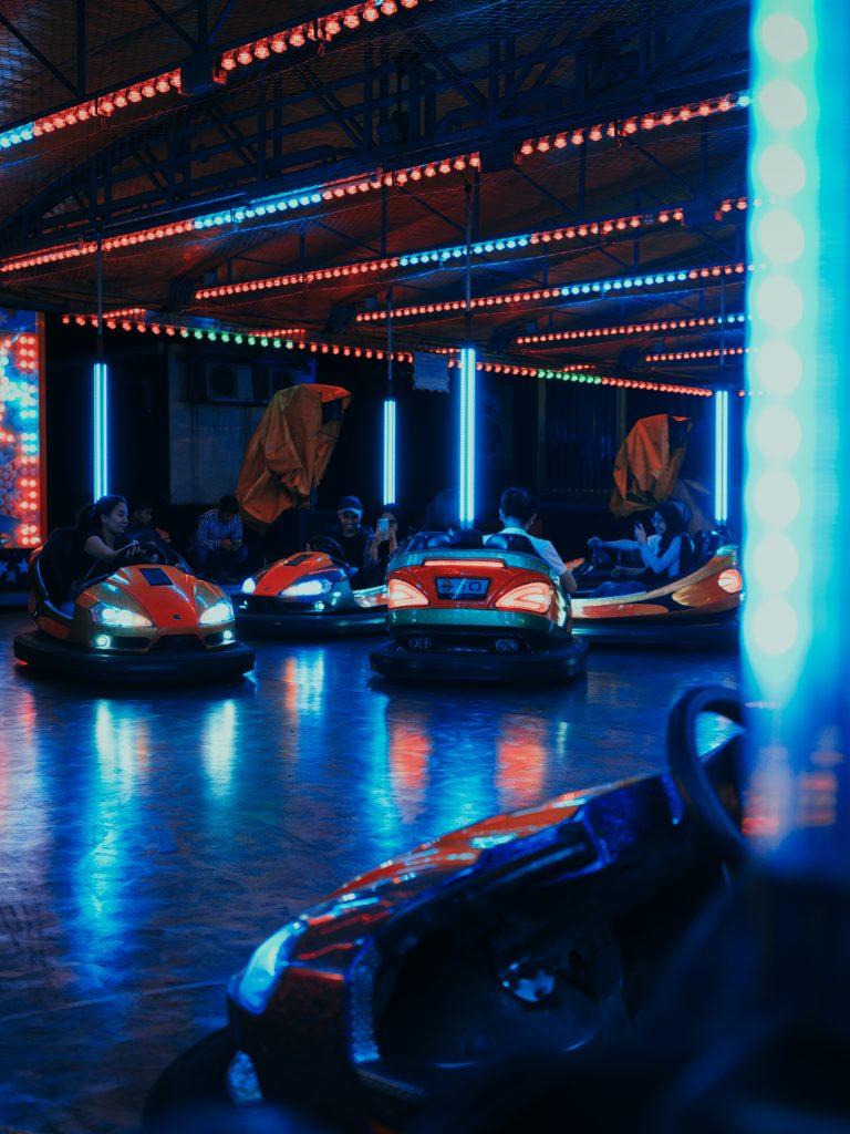 people riding on bump cars 2389371 -  SEO